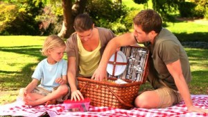 stock-footage-family-preparing-a-picnic-on-the-grass-in-the-park