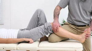 stock-footage-physiotherapist-massaging-the-shin-bone-of-a-patient-in-a-therapy-room