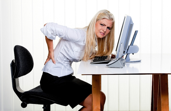 woman-with-back_pain-at-desk
