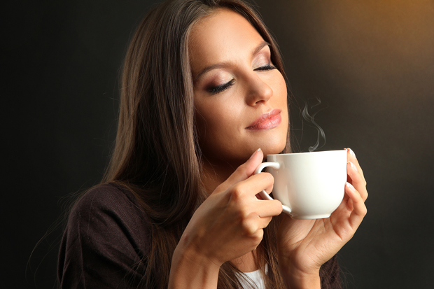 bigstock-beautiful-young-woman-with-cup-38907037