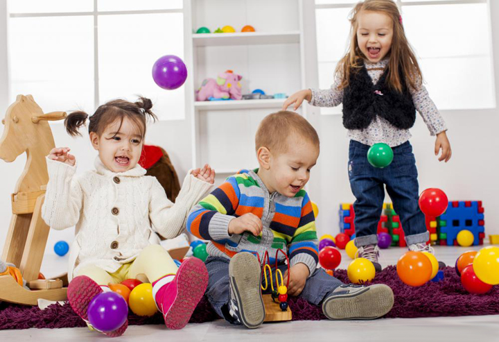 three-children-playing-with-colorful-toys