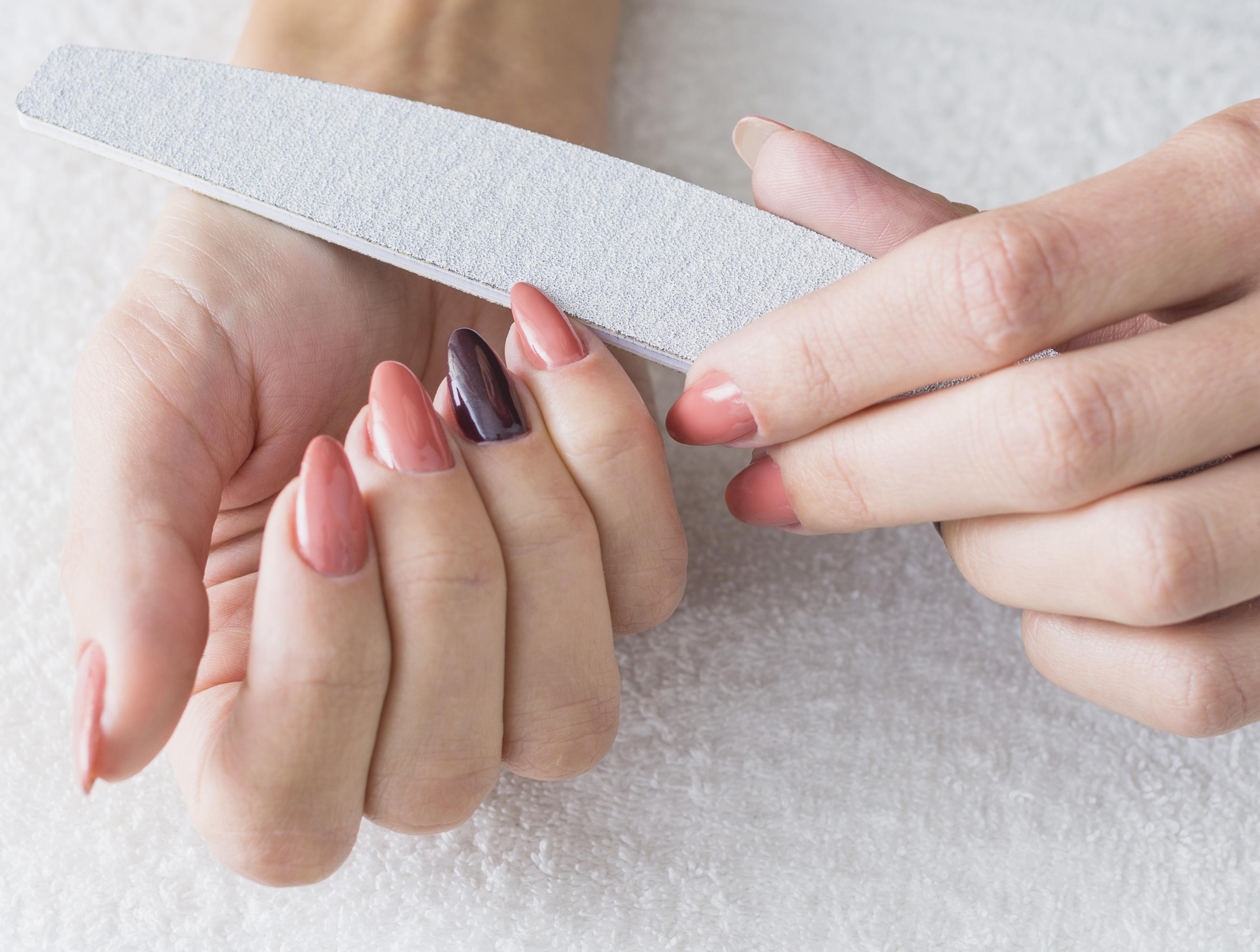 Woman making manicure